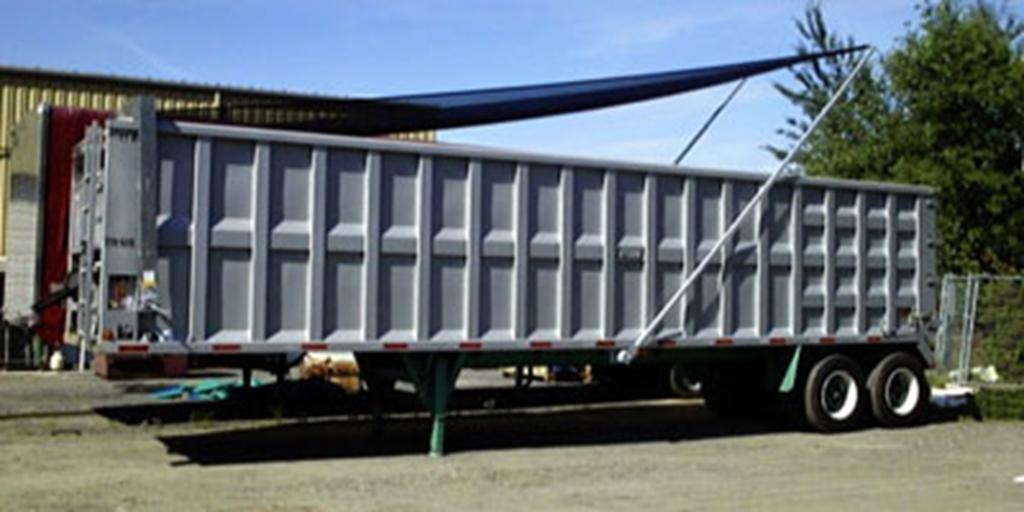 gray roll-off dump truck
